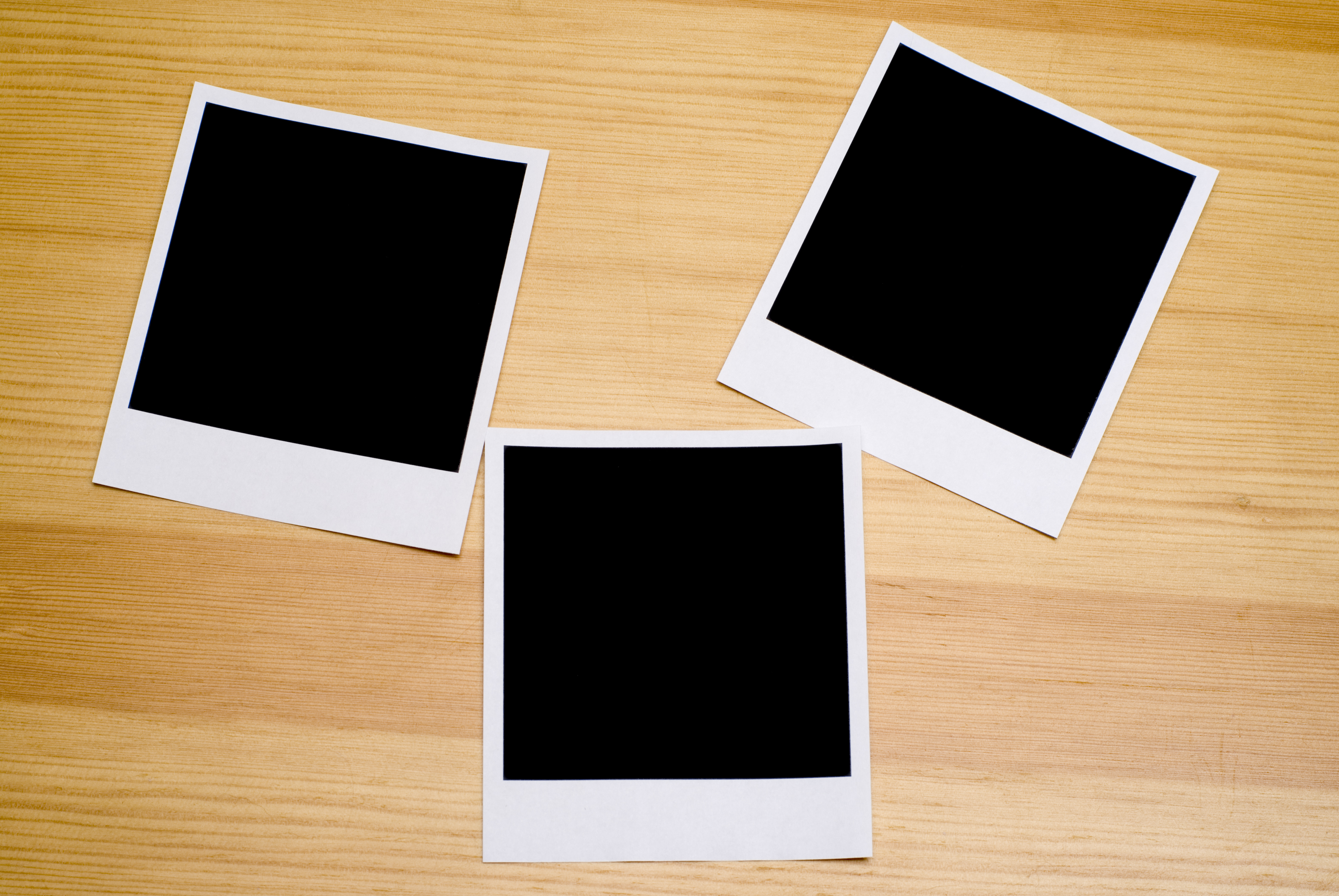 Empty photo pictures on a table.
